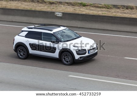 FRANKFURT, GERMANY - JULY 12, 2016: Citroen Cactus compact crossover car driving on the highway in Germany