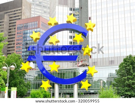 Frankfurt, Germany - July 19, 2015: Euro sign in front of European Central Bank. - stock photo