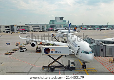 FRANKFURT, GERMANY-JULY 26, 2013: passengers airplane decking. With 38 million passengers per year it is one of the most important airport in Europe. - stock photo