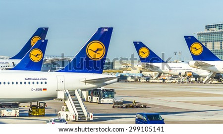 FRANKFURT, GERMANY - JULY 6, 2015: Terminal 1 with passengers airplane decking in Frankfurt, Germany. With 38 million passengers per year it is one of the most important airport in Europe. - stock photo