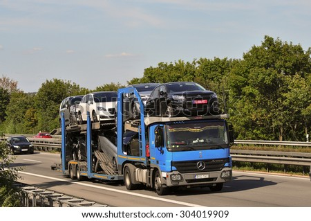 FRANKFURT,GERMANY-JULY 31: truck with cars on the highway on July 31,2015 in Frankfurt,Germany. - stock photo