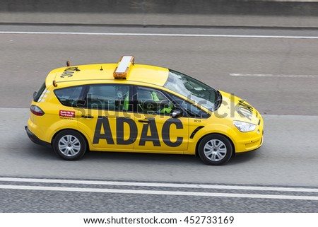 FRANKFURT, GERMANY - JULY 12, 2016: Yellow ADAC Ford S-Max on the highway. The ADAC (Allgemeiner Deutscher Automobil-Club) is an automobile club in Germany - stock photo