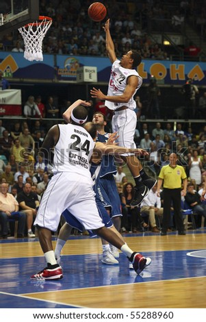 FRANKFURT, GERMANY - JUNE  15: Baskeball player Brian Roberts of Brose Baskets Bamberg is jumping to the basket at german playoff game June 15, 2010 in Frankfurt