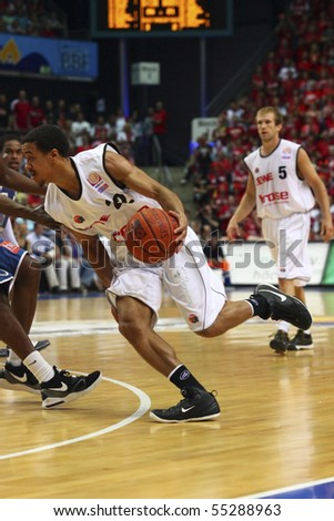 FRANKFURT, GERMANY - JUNE  15: Baskeball player Brian Roberts of Brose Baskets Bamberg is running through defence at german playoff game June 15, 2010 in Frankfurt