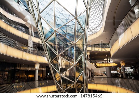 FRANKFURT, GERMANY - JUNE 29: inside view of the shopping mall MyZeil on June 29, 2013 in Frankfurt. MyZeil is a famous mall from architect Massimiliano Fuksas with the longest escalator in Germany. - stock photo