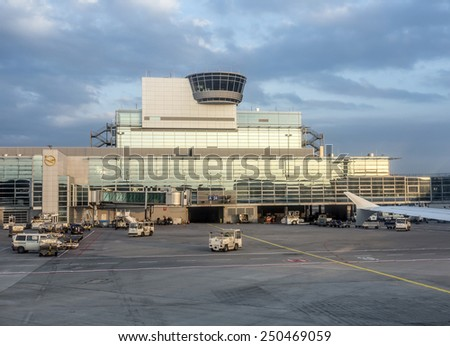 FRANKFURT, GERMANY - MAR 17, 2014: Flight control tower at Terminal 1 in late afternoonin Frankfurt, Germany. It is one of the busiest airport in Europe with 59 million passengers in 2011. - stock photo