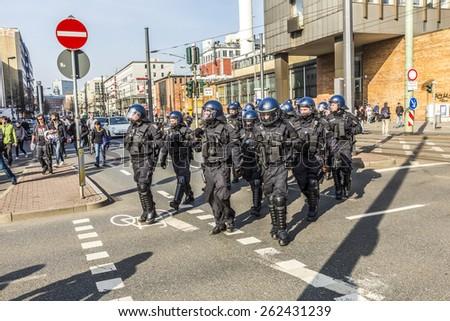 FRANKFURT, GERMANY - MAR 18, 2015: people demonstrate against EZB and Capitalism in Frankfurt, Germany. 9 tsd policemen guard the demo. - stock photo