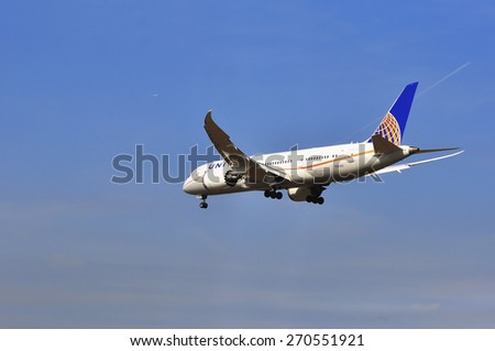FRANKFURT,GERMANY-MARCH 28:airplane of United Airlines above the Frankfurt airport on March 28,2015 in Frankfurt,Germany.United Airlines is an American major airline headquartered in Chicago, Illinois