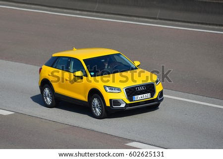 FRANKFURT,GERMANY-MARCH 16: Audi car on the freeway on March 16,2017 in Frankfurt,Germany.Audi-German automobile manufacturer that designs,engineers, produces, markets and distributes luxury vehicles.
