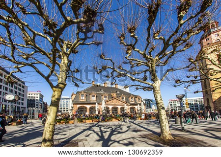 FRANKFURT, GERMANY- MARCH 2: people enjoy the sunny day at March 2,2013 in Frankfurt, Germany. The baroque building Hauptwache was built in 1730 as a police station and serves nowadays as a cafe.