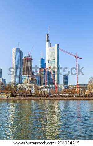 FRANKFURT, GERMANY - MARCH 3, 2013: Skyline of Frankfurt, Germany. Frankfurt is the largest financial centre in continental Europe. taken from Eisener Steg bridge.