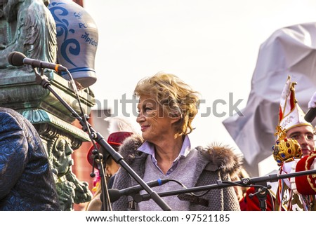FRANKFURT, GERMANY - MARCH 5: The mayor Petra Roth holds a speech and gives the key for the town hall in the yearly carneval event to the carnival people  on March 5, 2011 in Frankfurt, Germany.