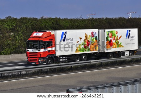 "FRANKFURT,GERMANY-MARCH 28: truck of HAVI Logistics on the highway on March 28,2015 in Frankfurt,Germany.HAVI Logistics is ""The Global Lead Logistics Provider"" for food and non-food logistics. - stock photo"