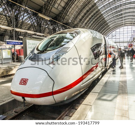 FRANKFURT, GERMANY - MAY 16, 2014: Inside the Frankfurt central station in Frankfurt, Germany. With about 350.000 passengers per day its the most frequented railway station in Germany. - stock photo