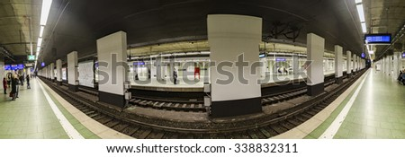 FRANKFURT, GERMANY - NOV 11, 2015: people wait at the metro station Hauptbahnhof  for the arriving train in Frankfurt, Germany. The Metro station was inaugurated 1978 after 8 years under construction.