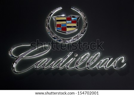 FRANKFURT, GERMANY - SEP 13: Cadillac symbol at the IAA motor show on Sep 13, 2013 in Frankfurt. More than 1.000 exhibitors from 35 countries are present at the world's largest motor show. - stock photo
