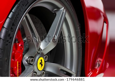 FRANKFURT, GERMANY - SEP 20: Close-up of the Ferrari FF at the IAA motor show on Sep 20, 2013 in Frankfurt. More than 1.000 exhibitors from 35 countries are present at the world's largest motor show.  - stock photo