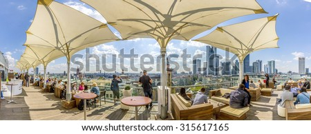 FRANKFURT, GERMANY - SEP 11, 2015: people enjoy the  view from the panorama platform to the skyline in Frankfurt, Germany. The Kaufhof platform is open to public from 9.30 am to 9 pm and is free. - stock photo