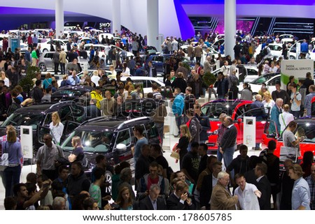 FRANKFURT, GERMANY - SEP 20: Visitors at the IAA motor show on Sep 20, 2013 in Frankfurt. More than 1.000 exhibitors from 35 countries are present at the world's largest motor show.