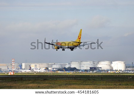 FRANKFURT,GERMANY-SEPT 24:TUIfly Boeing 737 above the Frankfurt airport on September 24,2015 in Frankfurt,Germany.TUIfly is a German leisure airline owned by the travel and tourism company TUI Group.