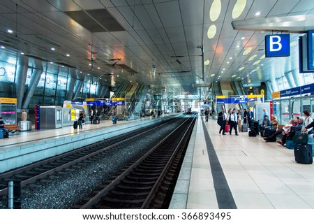 FRANKFURT, GERMANY - SEPTEMBER 14, 2009: Frankfurt Airport Train station with people commuting on the platform during rush hour. Fraport Train station is on of the bussiest train station in Germany - stock photo