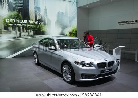 FRANKFURT, GERMANY - SEPTEMBER 11: Frankfurt international motor show (IAA) 2013. BMW 5 Series New generation - world premiere - stock photo