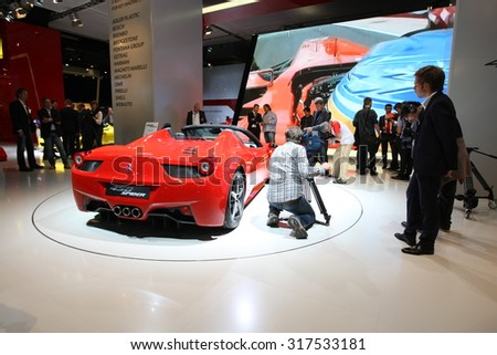 Frankfurt, Germany - September 13: Journalists shooting and filming the latest Ferrari model on IAA Frankfurt Motor Show September 13, 2011 in Frankfurt.