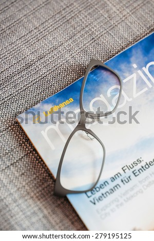 FRANKFURT GERMANY - SEPTEMBER 2, 2014: Lufthansa Magazine the in-flight magazine of Lufthansa Airlines appears every month and covers subjects related to aviation, travel, celebrities, entertainment - stock photo