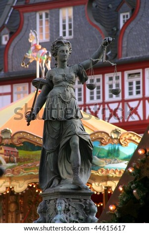 Frankfurt, Germany. The  Lady Justice Statue on Christmas - stock photo
