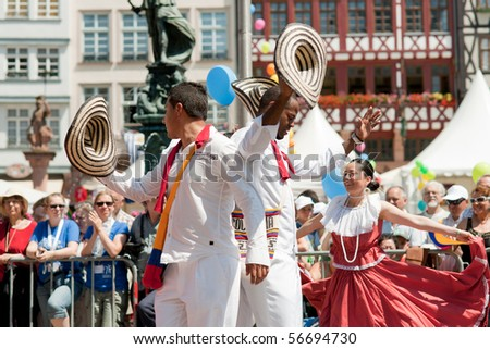 FRANKFURT - JUNE 26: Colombians dance in traditional costumes at the Parade der Kulturen. June 26, 2010 in Frankfurt, Germany. - stock photo