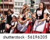 FRANKFURT - JUNE 26. Three young girls performing a traditional italian dance at the Parade der Kulturen. June 26, 2010 in Frankfurt, Germany. - stock photo