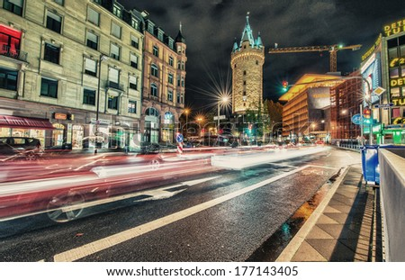FRANKFURT - OCT 30, 2013: City lights at night with car light trails. Frankfurt is the largest financial centre in continental Europe and ranks among the world's leading financial centres.