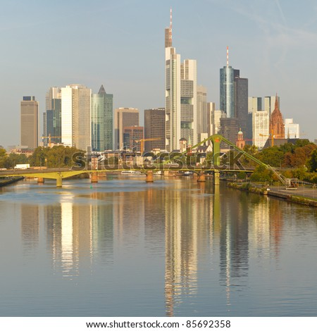 Frankfurt's Skyline reflecting in the Main River. Frankfurt is the financial center of Germany. All major German banks are headquartered in the city.
