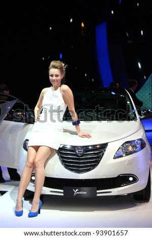 FRANKFURT - SEPT 13: Lancia Ypsilon and an unidentified blond model shown at the 64th IAA (Internationale Automobil Ausstellung) on September 13, 2011 in Frankfurt, Germany.