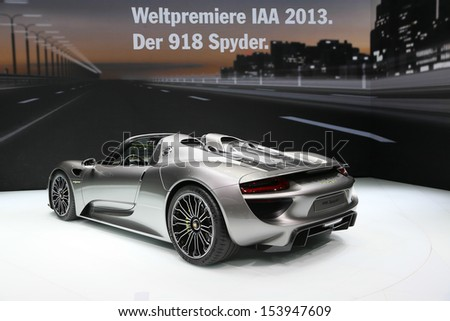 FRANKFURT - SEPT 10: World Premiere new Porsche 918 Spyder shown at the 65th IAA (Internationale Automobil Ausstellung) on September 10, 2013 in Frankfurt, Germany. - stock photo