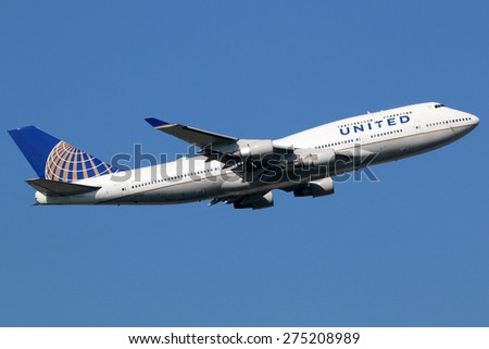 FRANKFURT - SEPTEMBER 17: United Airlines Boeing 747-400 airplane taking off on September 17, 2014 in Frankfurt. United Airlines is the world's largest airline with 138 million passengers. - stock photo