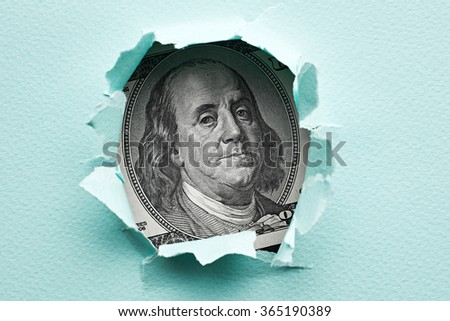 Franklin in the hole of blue paper
