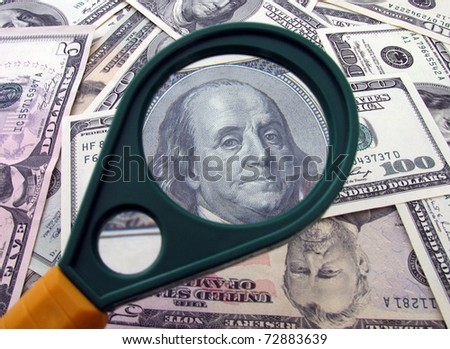 Franklin on 100 dollars through magnifying glass