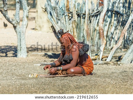 FRANSFONTEIN, NAMIBIA - JULY 09, 2014: A young woman Himba tribe. The Himba are indigenous peoples living in northern Namibia, in the Kunene region of South-West Africa - stock photo