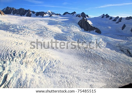 Franz Josef glacier at top view from Helicopter - stock photo