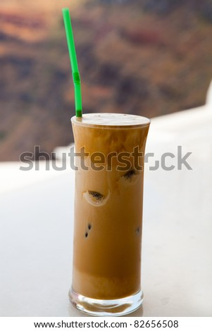 Frappe on a cafe table in Thira, Santorini, Greece - stock photo
