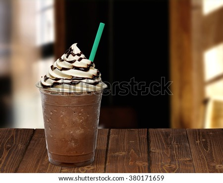 Frappuccino on wooden table - stock photo