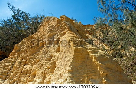 FRASER ISLAND - DECEMBER 31: The Pinnacle (colored sands) view on December 31, 2013 in Queensland, Australia. The Fraser Island is considered to be the largest sand island in the world. - stock photo