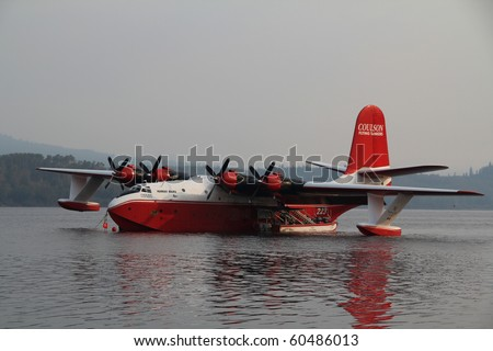 FRASER LAKE, BC - AUG 23: Coulson flying watertanker on location to assist the Interior firefighters with the raging forest fires in the area on Aug 23, 2010 in Fraser Lake, BC, Canada - stock photo