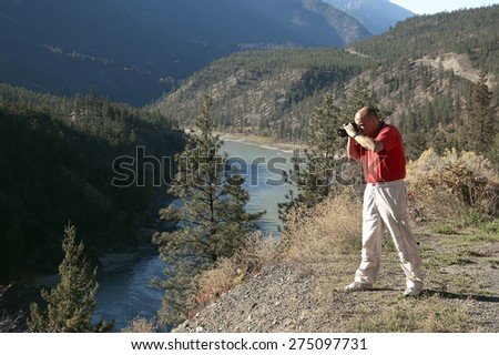 Fraser River, Canyon with photographer British Columbia, Canada - stock photo
