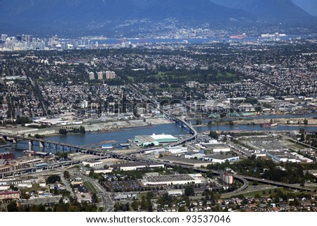 Fraser River with Richmond and Vancouver - stock photo