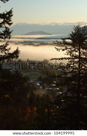 Fraser Valley Morning Fog, British Columbia. A blanket of fog covers the Fraser Valley east of Vancouver. British Columbia, Canada. - stock photo