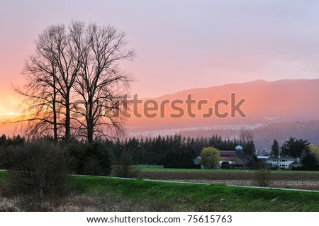 Fraser Valley Raining Sunset, farmhouse in Pitt Meadows - stock photo