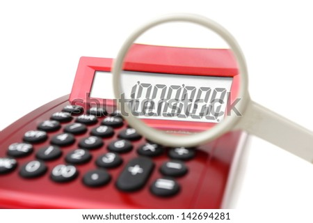Fraud concept with magnifier and calculator - stock photo