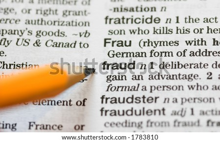 Fraud definition pointed out by pencil - stock photo